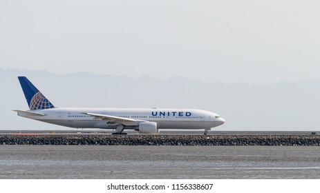 San Francisco, California - August 12th 2018: United Airlines Boeing 777-222 (registration N781UA) taxiis along the runway at San Francisco Airport.