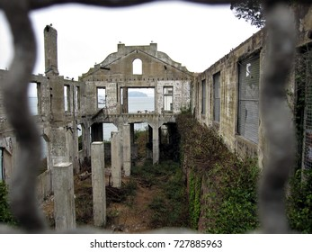 San Francisco, California - August 29, 2017: Remains of Officer's Club at Alcatraz Island through fence.
