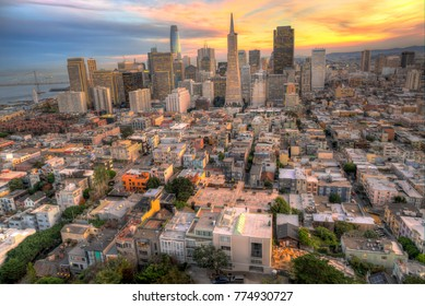 San Francisco, California - December 11, 2017: The View from the top of Coit Tower towards downtown as the sun is setting.
