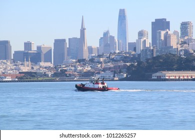 San Francisco, California; December 2, 2017; a tugboat in San Francisco Bay with San Francisco sklyline in the background