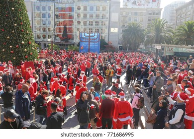 San Francisco, California - December 9, 2017: Thousands dress in festive Christmas holiday costumes gather for SantaCon in Union Square in San Francisco for the annual Santarchy event in December.