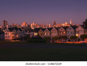 San francisco California. Famous houses called Painted Ladies and view of the city, during the sunset and the first lights of the night