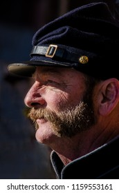 San Francisco, California - January 27, 2018: Union Soldier with mustache and dressed in Union soldier uniform in Civil War re-enactment event at Fort Point in San Francisco.