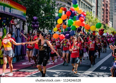 """SAN FRANCISCO, CALIFORNIA, JUNE 24, 2018:  GAY PRIDE PARADE - """"Many Identities, One Community"""" group marches"""