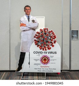 San Francisco, California - March 14, 2021: A cut out figure of Dr. Anthony Fauci greets the public at the entrance to the vaccination site in the Moscone Center, in San Francisco.
