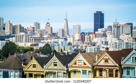 San Francisco California travel destination with Victorian architecture homes in front of huge modern urban skyline cityscape Row Houses and landmark architecture new and old