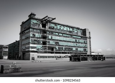 SAN FRANCISCO, CALIFORNIA, UNITED STATES, April 15, 2018: An abandoned, obsolete industrial building sits on a vacated property.
