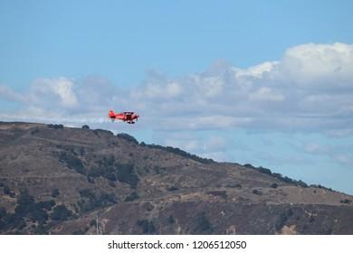 San Francisco, California / United states of America - October 6 2018: Stunt pilot in red plane ended full loop during San Francisco Fleet week