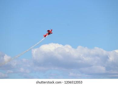 San Francisco, California / United states of America - October 6 2018: Stunt pilot in red plane starts full loop during San Francisco Fleet Week 2018