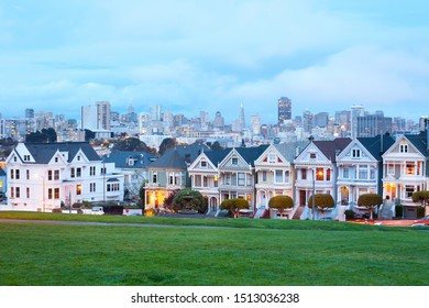 San Francisco, California, United States - March 15, 2012: Traditional Victorian Houses at Alamo Square known as Painted Laydies with downtown skyline in the back.