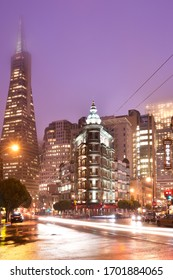 San Francisco, California, United States - Columbus Avenue with Sentinel building and Transamerica Pyramid Building at in a rainy day at night.