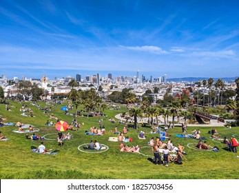 San Francisco, California  United States - September 26, 2020: Sunbathers aggregate outdoors at Dolores Park on a hot Saturday afternoon during Covid-19.