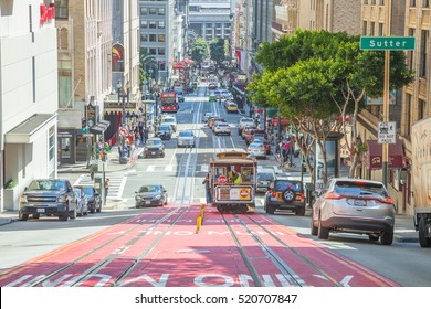 San Francisco, California, United States - August 17, 2016: Cable Car climbs the popular Powell Street hill in the busy central area of Union Square, San Francisco downtown.