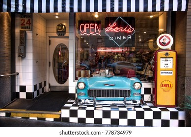 San Francisco, California, United States - circa 2016 - Lori's Diner retro nostalgic style cafe restaurant sutter street san francisco california with shell gas pump and muscle car chrome bumper