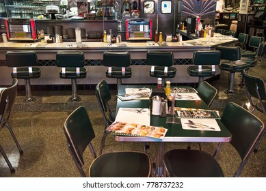 San Francisco, California, United States - circa 2016 - Interior of 1950s style retro diner cafe with stools, counter and juke boxes
