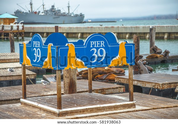 San Francisco, California, United States - August 14, 2016: Pier 39 sign at Fisherman's Wharf district. Pier 39 is a popular tourist landmark attraction for Sea Lions colony. Travel holidays concept.