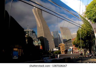 San Francisco, California, USA - 20th May 2015 : The Transamerica Pyramid and the surrounding buildings reflected on a black car body in San Francisco, USA