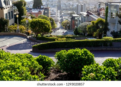 San Francisco, California, USA - April 02, 2018: Cars driving on Lombard Street with eight hairpin turns  in San Francisco, the crookedest street in the world.