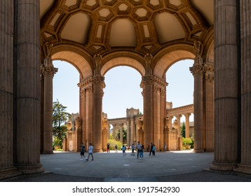San Francisco, California, USA - August 2019: People visiting the Palace of Fine Arts, a monumental structure constructed for the 1915 Expo