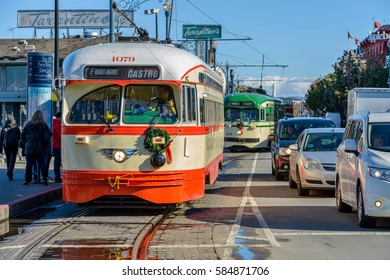 San Francisco, California, USA - January 5, 2017: The vintage streetcars of the historic F Market & Wharves Line running on a busy street at Fisherman's Wharf.