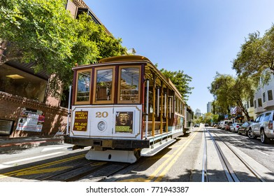 SAN FRANCISCO, CALIFORNIA, USA - JULY 19, 2017: A cable car near Fisherman's Wharf. Cable cars began operating here in 1873. This cable car system is the world's last manually operated system.