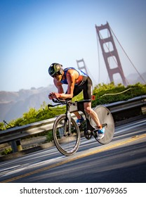 San Francisco, California, USA - June 3, 2018: Cameron Dye chases after the race leader during the bike portion of the 2018 Escape From Alcatraz Triathlon.