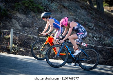 San Francisco, California, USA - June 3, 2018: Sarah Haskins (#38) passes Alicia Kaye (#32) on the final climb back to T2 before running to victory in the 2018 Escape From Alcatraz Triathlon.
