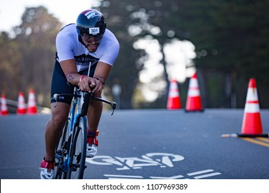San Francisco, California, USA - June 3, 2018: Daniel Reyes from Florida navigates the turns during the 2018 Escape From Alcatraz Triathlon.