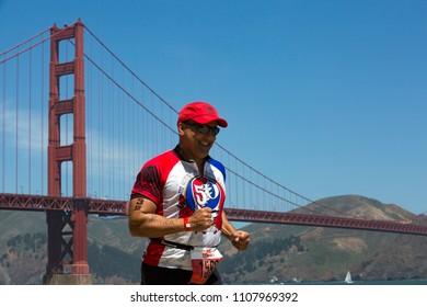 San Francisco, California, USA - June 3, 2018: Boomer Titan of Marina Del Rey, California runs the final stretch of the 2018 Escape From Alcatraz Triathlon.