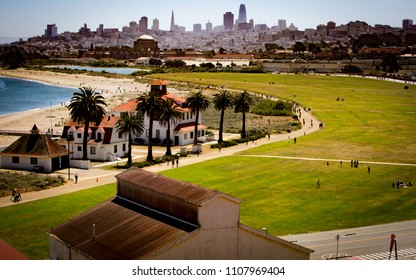 San Francisco, California, USA - June 3, 2018: Triathletes run through the Presidio toward Crissy Field with the skyline of San Francisco in the background at the 2018 Escape From Alcatraz Triathlon.