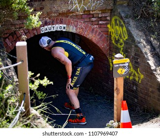 San Francisco, California, USA - June 3, 2018: This small tunnel was one of the many challenges triathletes encountered during the 2018 Escape From Alcatraz Triathlon.