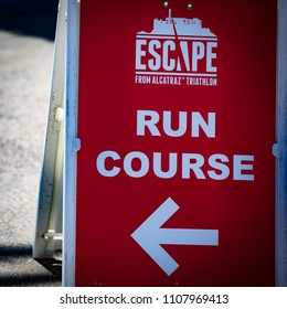 San Francisco, California, USA - June 3, 2018: A sign directs runners at the 2018 Escape From Alcatraz Triathlon.