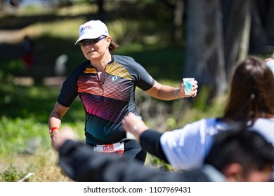 San Francisco, California, USA - June 3, 2018: A competitor takes water at an aid station during the 2018 Escape From Alcatraz Triathlon.