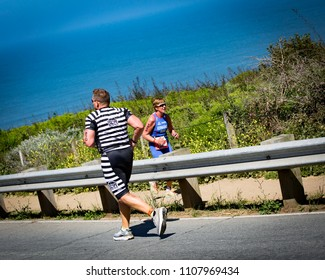 San Francisco, California, USA - June 3, 2018: Jim Bizily of Park City, Utah wears prisoner stripes while competing in the 2018 Escape From Alcatraz Triathlon.