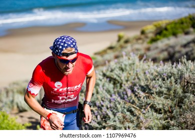 San Francisco, California, USA - June 3, 2018: Ben Kanute ascends the sand stairs at Baker Beach en route to winning the 2018 Escape From Alcatraz Triathlon.