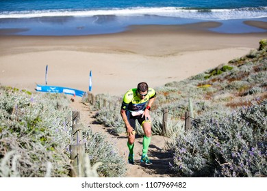 San Francisco, California, USA - June 3, 2018: Andy Potts navigates the sand stairs at Baker Beach en route to his fourth place finish at the 2018 Escape From Alcatraz Triathlon.