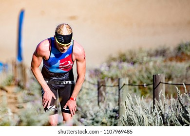 San Francisco, California, USA - June 3, 2018: Cameron Dye ascends the sand stairs at Baker Beach en route to his second place finish at the 2018 Escape From Alcatraz Triathlon.