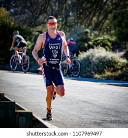 San Francisco, California, USA - June 3, 2018: Jason West shows his running speed en route to a third place finish at the 2018 Escape From Alcatraz Triathlon.
