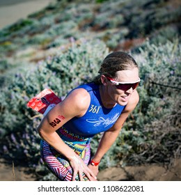 San Francisco, California, USA - June 3, 2018: Alicia Kaye climbs up the sand stairs at Baker Beach en route to a second place finish at the 2018 Escape From Alcatraz Triathlon.