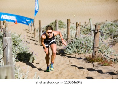 San Francisco, California, USA - June 3, 2018: Lauren Goss charges up the sand ladder at the 2018 Escape From Alcatraz Triathlon on her way to a top-three finish.