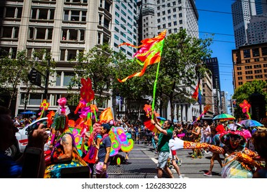 SAN FRANCISCO, CALIFORNIA / USA - JUNE 24, 2018: California LGBTQ Pride Parade. People wave rainbow flags on Market Street to support lesbians, gays, bisexuals, transgenders and queers.