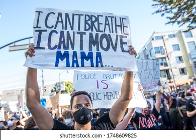 San Francisco, California, USA, June 03, 2020, Protest after George Floyd death, Black Lives Matter group standing against police and carrying a protest banner signs