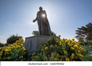SAN FRANCISCO, CALIFORNIA, USA - May 31, 2019: Sun Peaking Through a Statue of Christopher Columbus in San Francisco