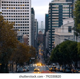 San Francisco, California / USA - Oct 30th 2017: Historical view of California Street from Nob Hill where Cable cars run and Bay bridge can be seen from distance.