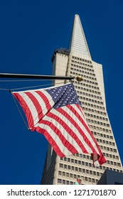 SAN FRANCISCO, CALIFORNIA, USA - OCTOBER 12, 2018:  Detail of a United States flag and the Pyramid Transamerica building in the financial district of San Francisco, California, USA