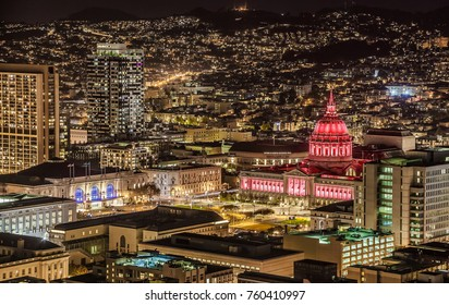 SAN FRANCISCO, CALIFORNIA, USA - OCTOBER 28, 2017: City Hall at night illuminated with blue and white projectors. Construction was completed in 1915.