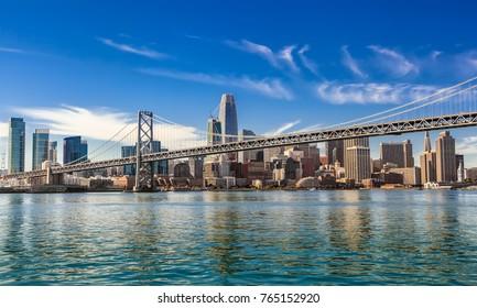 SAN FRANCISCO, CALIFORNIA, USA - OCTOBER 24, 2017: Downtown San Francisco and Oakland Bay Bridge on sunny day