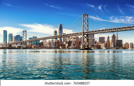 SAN FRANCISCO, CALIFORNIA, USA - OCTOBER 24, 2017: Downtown San Francisco and Oakland Bay Bridge on sunny day
