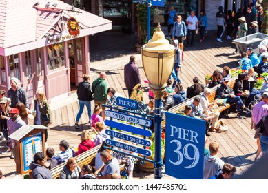 SAN FRANCISCO, CALIFORNIA USA - SEPTEMBER 17, 2018: Visitors walk on Pier 39, stores and restaurants on a sunny day