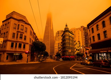 San Francisco, California, USA, September 09, 2020, Wildfire orange yellow sky in the bay area san francisco downtown air pollution sky buildings architectures